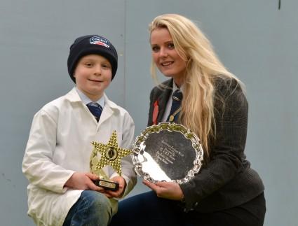 Junior Champion, Andrew Hamill with judge, Kirree Kermode
